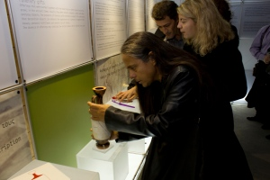 Photo of a man handling a vase exhibit at the exhibition